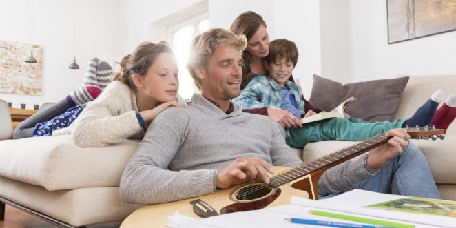 Family situation with guitar in living room