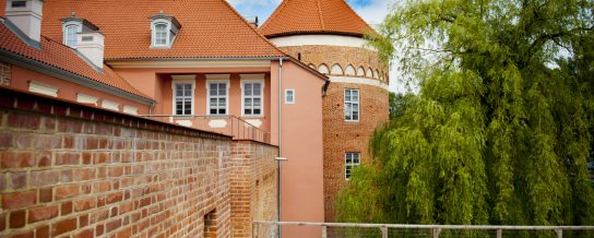 Bishops Palace in Lidzbark Poland with Monk and Num roof tile
